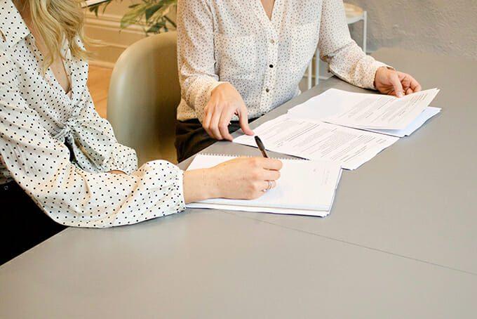 cannabis HR generalist explaining paper work to new employee