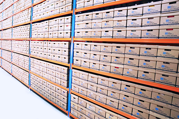 boxes stacked in neat rows at a cannabis warehouse